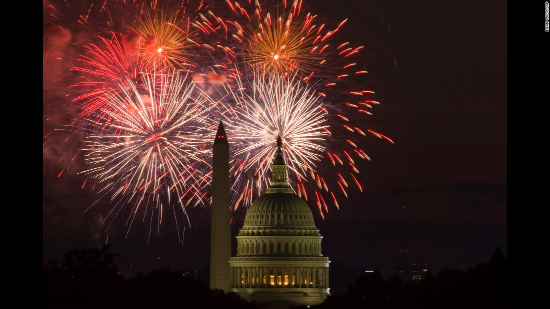 Fireworks illuminate the sky over the U.S. Capitol and the Washington Monument.