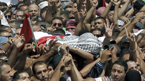 :Relatives and friends of Mohammed Abu Khedair carry his body to the mosque during his funeral on July 4, 2014.