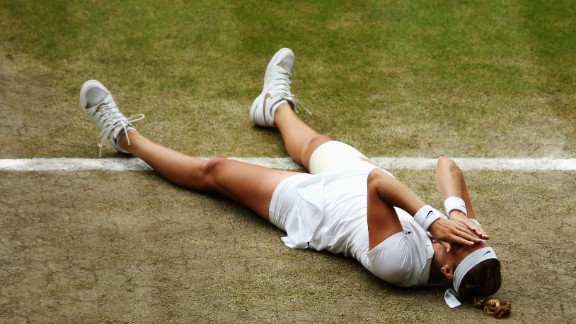 Kvitova slumps to the ground after securing the second set 6-0 and ensuring the second Wimbledon title of her career.