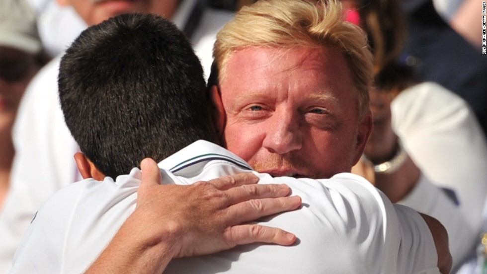 Djokovic embraces coach Boris Becker after his epic five-set victory over Federer on Centre Court.