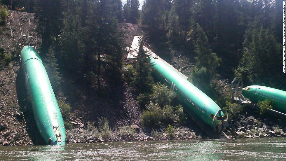 Three Boeing 737 fuselages slid down a steep embankment into the Clark Fork River following a train derailment in western Montana on Thursday, July 3.