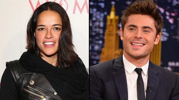 Actors Michelle Rodriguez -- who was previously linked to model Cara Delevingne -- and Zac Efron stirred relationship rumors when they were spotted kissing on a boat in Italy in July 2014 but reportedly only lasted two months as a couple.