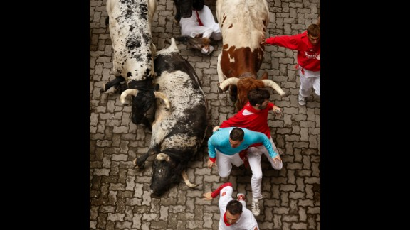Some bulls fall as they race through Pamplona