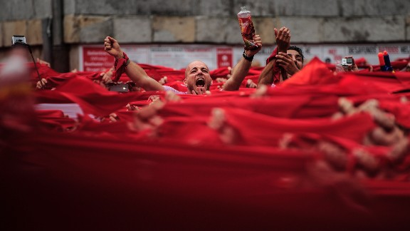 Revelers kick off the San Fermin festival with a messy party in Pamplona