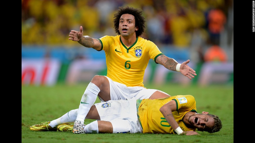 Brazil's Marcelo appeals to the referee as his teammate Neymar lies on the ground injured Friday, July 4, during the World Cup quarterfinal against Colombia in Fortaleza, Brazil. Brazil won the match 2-1, but Neymar suffered a broken vertebra on a challenge from Juan Camilo Zuniga.