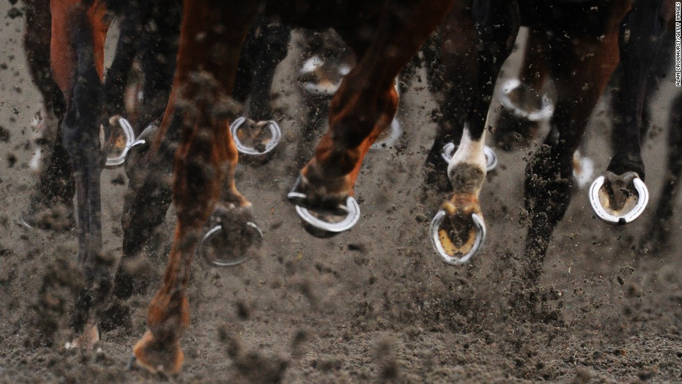 Horse hooves are seen Wednesday, July 2, at Kempton Park Racecourse in Sunbury, England.