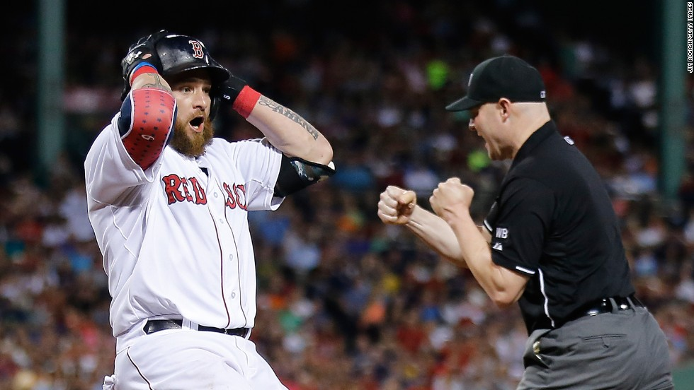 Jonny Gomes, left fielder for the Boston Red Sox, reacts after he was called out at first base during a home game against Baltimore on Saturday, July 5.