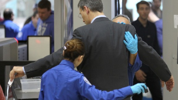 An air traveler is patted down after passing through a full-body scanner at Los Angeles International Airport (LAX) on February 20, 2014 in Los Angeles, California.