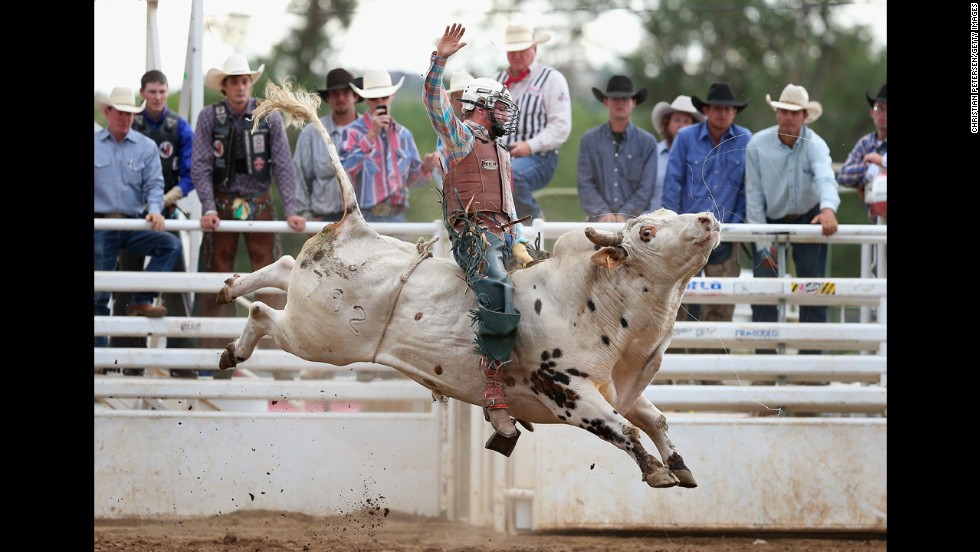 "Sam Wyatt rides a bull Saturday, July 5, during the ""world's oldest rodeo"" in Prescott, Arizona. The event was first held in 1888, according to <a href=""http://www.worldsoldestrodeo.com/about-us/our-history"" target=""_blank"">its website</a>."