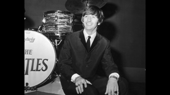 """Suit and tie was a staple in the early days for British drummer Ringo Starr, pictured here on his 24th birthday in 1964.The look was typical of the British """"Mod"""" subculture, though when asked in 'A Hard Day's Night' if he was a """"mod or a rocker,"""" Ringo replied, """"I'm a mocker."""""""