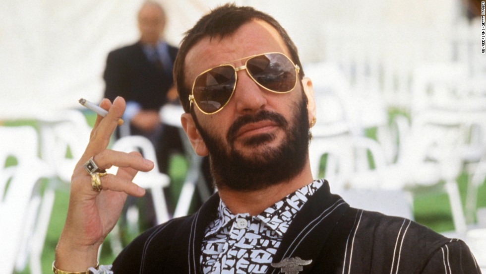 "Ringo Starr posed, holding cigarette, wearing sunglasses in 1987. Ringo famously sang, ""it don't come easy,"" but at moments like this he sure makes it look easy."