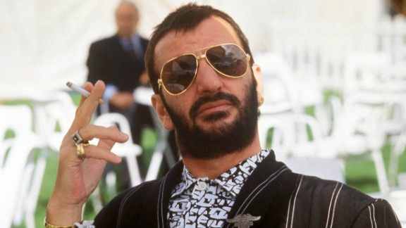 """Ringo Starr posed, holding cigarette, wearing sunglasses in 1987. Ringo famously sang, """"it don't come easy,"""" but at moments like this he sure makes it look easy."""