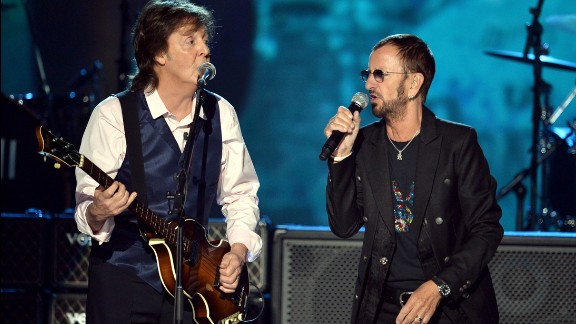 """Recording artists Paul McCartney, left, and Ringo Starr perform onstage during """"The Night That Changed America: A GRAMMY Salute To The Beatles"""" at the Los Angeles Convention Center on January 27."""