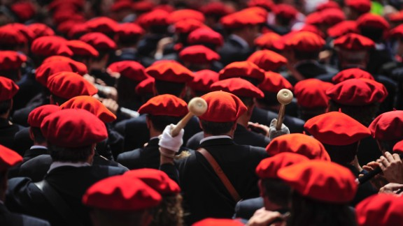Musicians wearing traditional red berets play during the official opening on July 6.