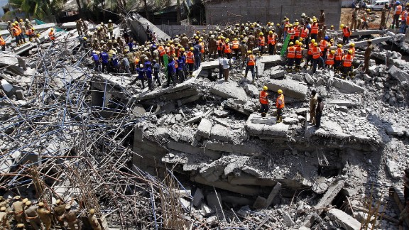 On the same day as the New Delhi building collapse, an eleven-floor building under construction came crashing down in the southern Indian city of Chennai, killing 61 workers. Workers are pictured clearing the scene on June 30.