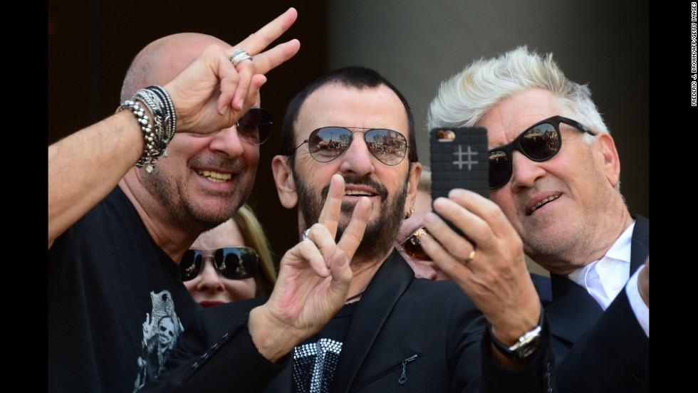 Ringo Starr, the former drummer of the Beatles, takes a selfie Monday, July 7, with fashion designer John Varvatos, left, and film director David Lynch, right. Behind them is Starr's wife, Barbara Bach. They were in Hollywood celebrating Starr's 74th birthday and the launch of a charitable initiative benefiting the Ringo Starr Peace & Love Fund.