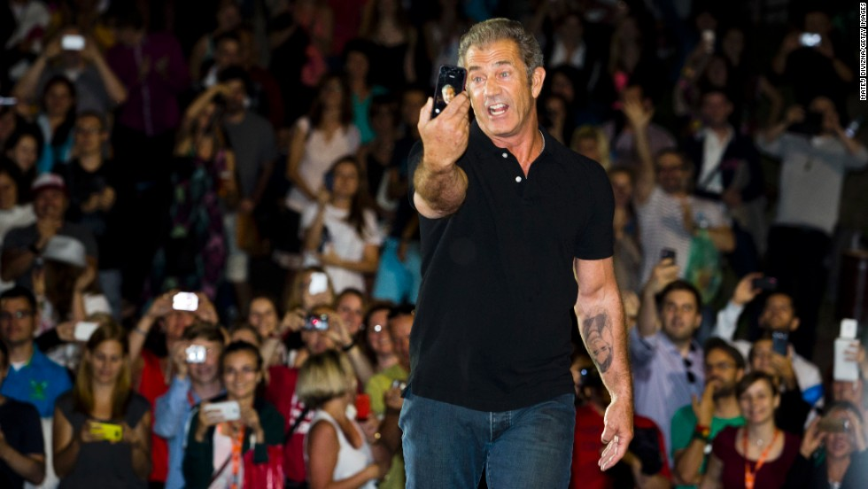 "Actor Mel Gibson snaps a selfie Friday, July 4, in front of fans at the Karlovy Vary International Film Festival in Karlovy Vary, Czech Republic. Gibson was putting on an outdoor screening of his classic film ""Mad Max."""