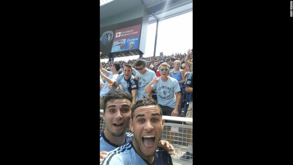 "Dom Dwyer, a forward on Sporting Kansas City, <a href=""https://twitter.com/SportingKC/status/485875566159994880"" target=""_blank"">takes a selfie</a> with fans and teammate Soony Saad, left, after scoring a goal Sunday, July 6, in a Major League Soccer match against the Chicago Fire. He got a yellow card, however, for the cell phone celebration. The game ended in a 1-1 draw."
