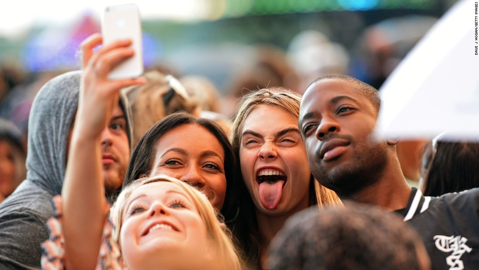 "Model Cara Delevingne sticks her tongue out as she takes a selfie with fans Sunday, July 6, at the British Summer Time festival in London. <a href=""http://www.cnn.com/2014/07/02/world/gallery/look-at-me-0702/index.html"">See 21 selfies from last week</a>"