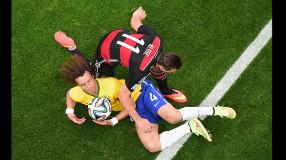 Klose and David Luiz compete for the ball.