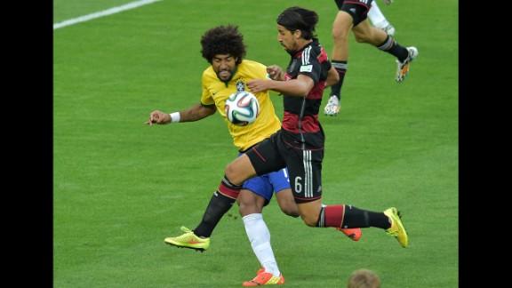 Brazilian defender Dante, left, fights off Germany's Sami Khedira.