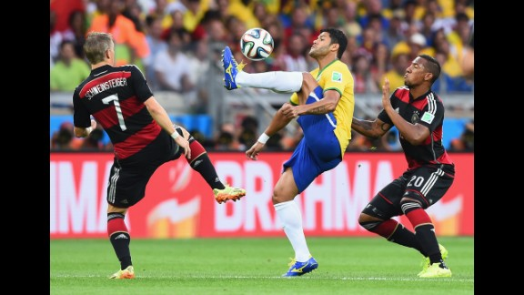 Hulk shields the ball from Schweinsteiger and German defender Jerome Boateng.