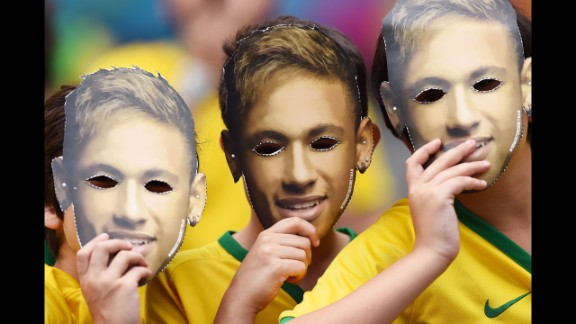 Fans wear masks of Neymar's face prior to the match. See the best World Cup photos from July 5