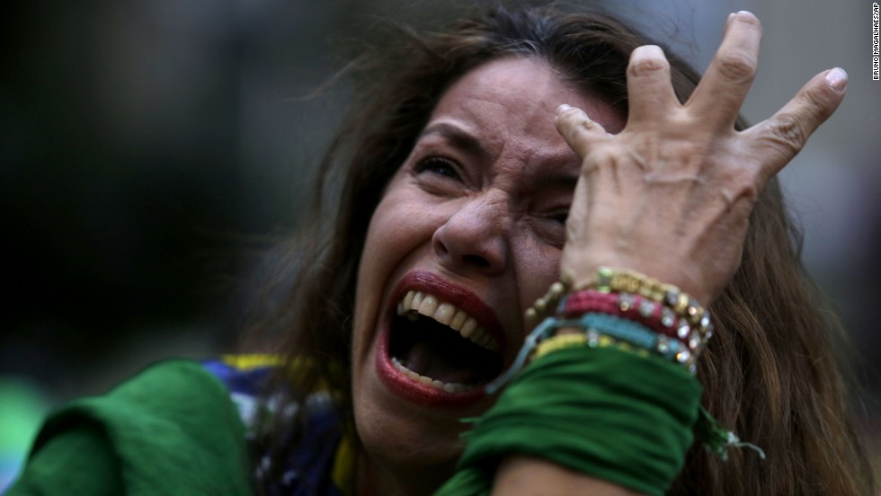A Brazil soccer fan cries as she watches the match in Belo Horizonte.