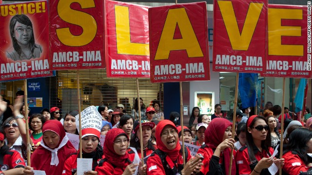 Migrant workers from Indonesia protest against modern slavery during a Labour Day rally in Hong Kong on May 1, 2014.