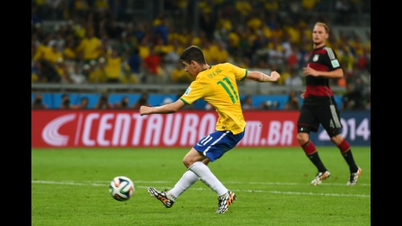 Oscar of Brazil scores a late second-half goal against Germany during a World Cup semifinal match played Tuesday, July 8, in Belo Horizonte, Brazil. But it was no consolation for the home team, which was knocked out of the tournament by a stunning score of 7-1.