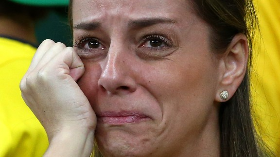 A dejected Brazil fan looks on during the 2014 FIFA World Cup Brazil Semi Final match between Brazil and Germany at Estadio Mineirao on July 8, 2014 in Belo Horizonte, Brazil.