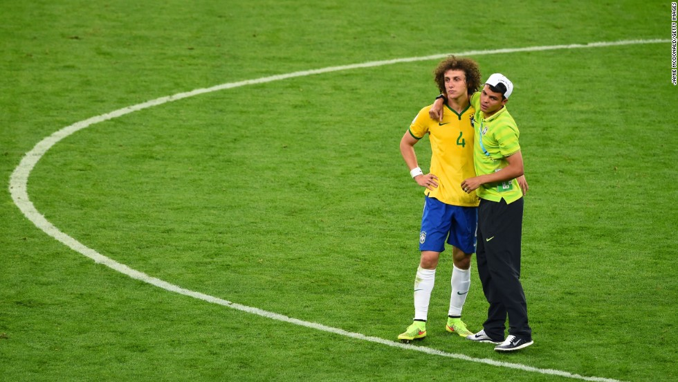 Brazil's Thiago Silva, right, consoles teammate David Luiz after the match. Silva, Brazil's captain, had been suspended and couldn't play.