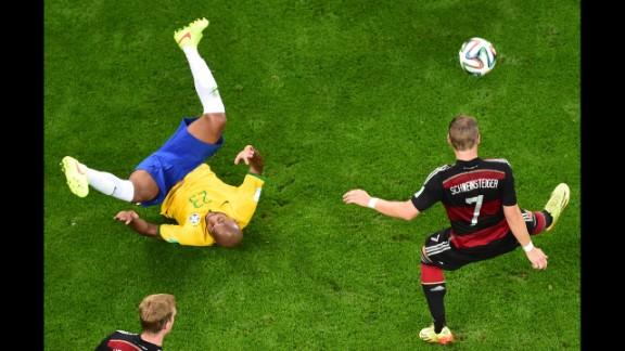 German midfielder Bastian Schweinsteiger controls the ball.