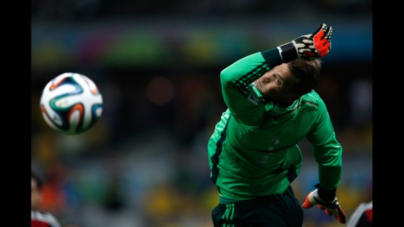German goalkeeper Manuel Neuer dives for the ball.