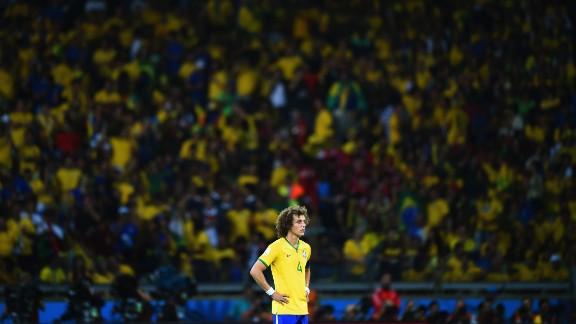 David Luiz looks on after Germany's sixth goal.