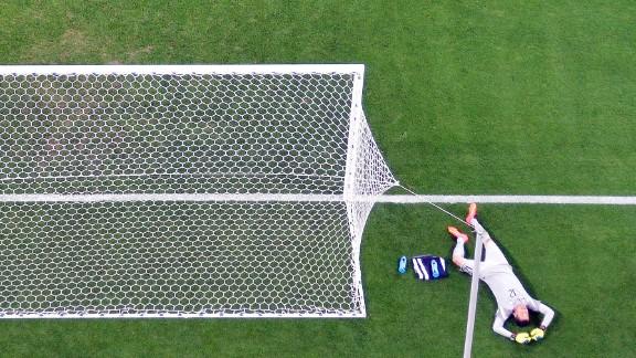 Brazilian goalkeeper Julio Cesar reacts after failing to stop a shot.