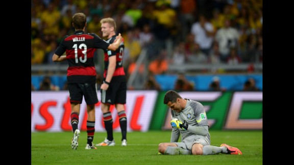 Julio Cesar shows his dejection after conceding the sixth goal.