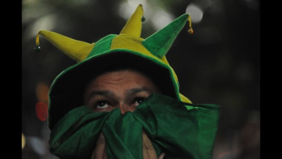 A Brazil fan watches the match on television in Rio de Janeiro.