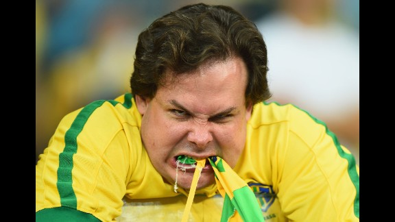 A Brazil fan reacts after his team was crushed 7-1 by Germany in a World Cup semifinal match played Tuesday, July 8, in Belo Horizonte, Brazil. The emotions in the country were reminiscent of 1950, when Brazil last hosted the World Cup and suffered a heartbreaking defeat.