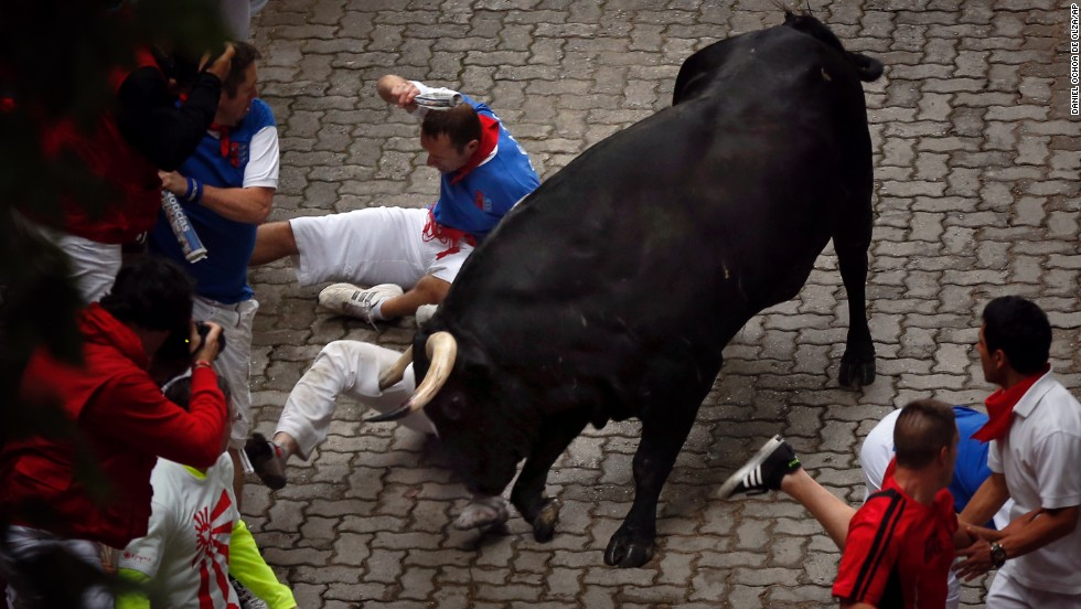 "Bill Hillmann, of Chicago, <a href=""http://www.cnn.com/2014/07/09/world/gallery/american-gored/index.html"">is gored on his right leg</a> by a bull on July 9. Hillmann has been running in Pamplona for about a decade, and he recently co-authored a book entitled ""Fiesta, How to Survive the Bulls of Pamplona."""