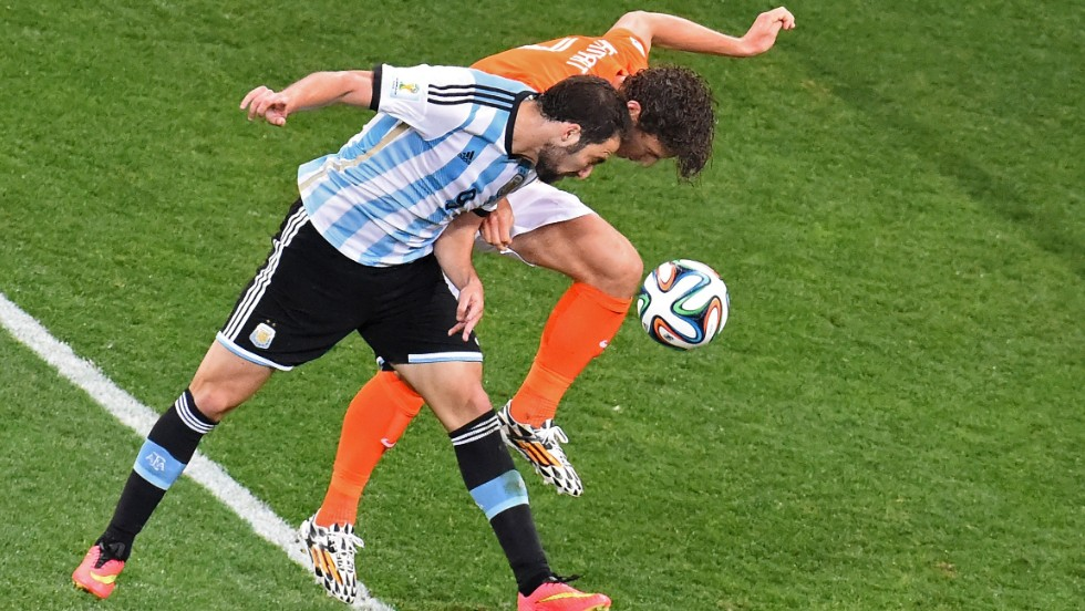 Caption:Argentina's forward Gonzalo Higuain (L) and Netherlands' defender Daley Blind vie for the ball during the semi-final football match between Netherlands and Argentina of the FIFA World Cup at The Corinthians Arena in Sao Paulo on July 9, 2014. AFP PHOTO / CHRISTOPHE SIMON (Photo credit should read CHRISTOPHE SIMON/AFP/Getty Images)