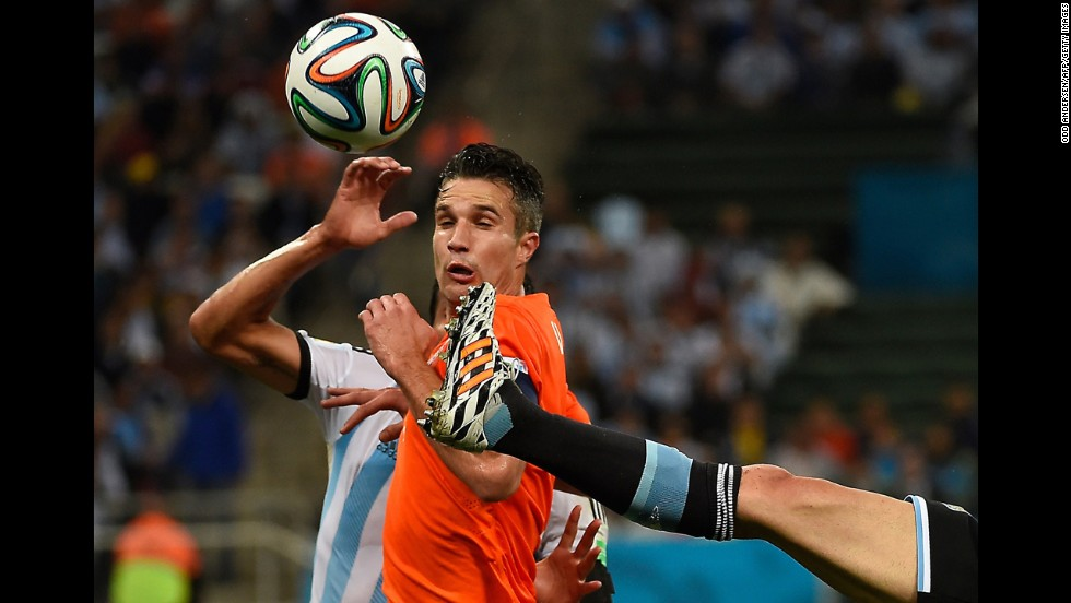 Netherlands forward Robin van Persie tries to avoid an Argentina player's boot during the World Cup semifinal played Wednesday, July 9, in Sao Paulo, Brazil.