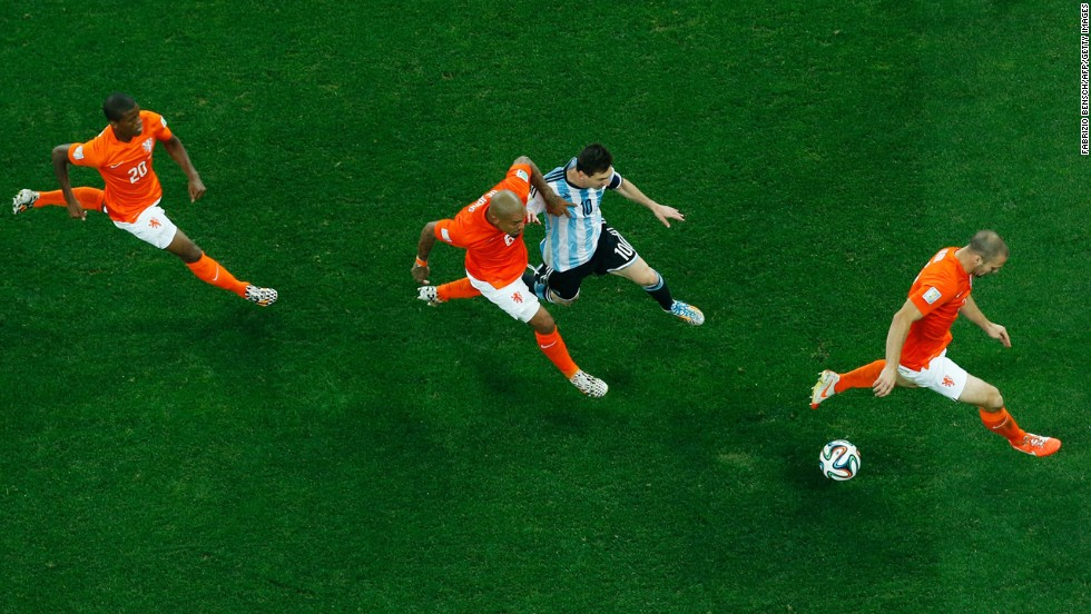 Argentina's Lionel Messi, second from right, is marked by Dutch midfielder Nigel De Jong during the World Cup semifinals Wednesday, July 9, in Sao Paulo, Brazil. Argentina won the match in a penalty shootout. Messi would eventually win the Golden Ball, which is awarded to the World Cup's best player.