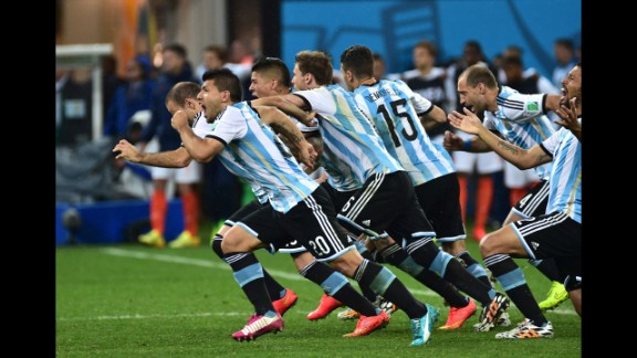 Argentina players run to celebrate their victory after a penalty shoot-out following extra time during their World Cup semifinal match against the Netherlands on Wednesday, July 9, in Sao Paulo, Brazil. Argentina defeated the Netherlands 4-2 on penalties and will go on to face Germany in the final.