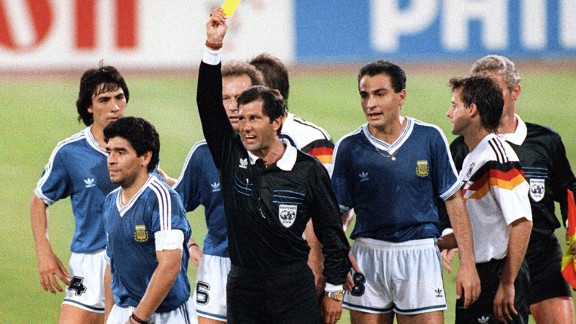 Mexican referee Ernesto Codesal Mendez gives a yellow card to  Maradona in the 1990 World Cup final between Argentina and West Germany, who won the game 1-0.