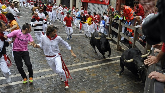 Participants run in front of bulls on July 9.