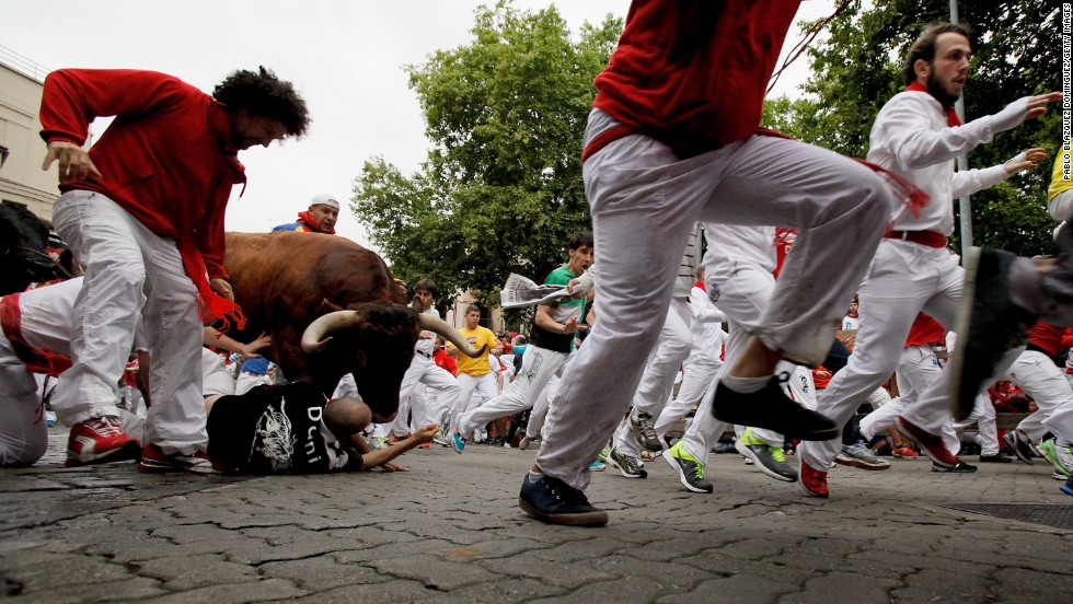 A bull jumps over revelers near the end of the run on July 9.