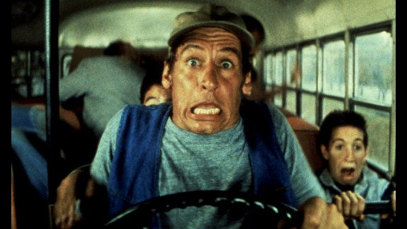 """Meeting characters like maintenance man and country philosopher Ernest can make camp a growth experience for kids. Here in 1987's """"Ernest Goes to Camp,"""" Jim Varney takes campers for a spin."""