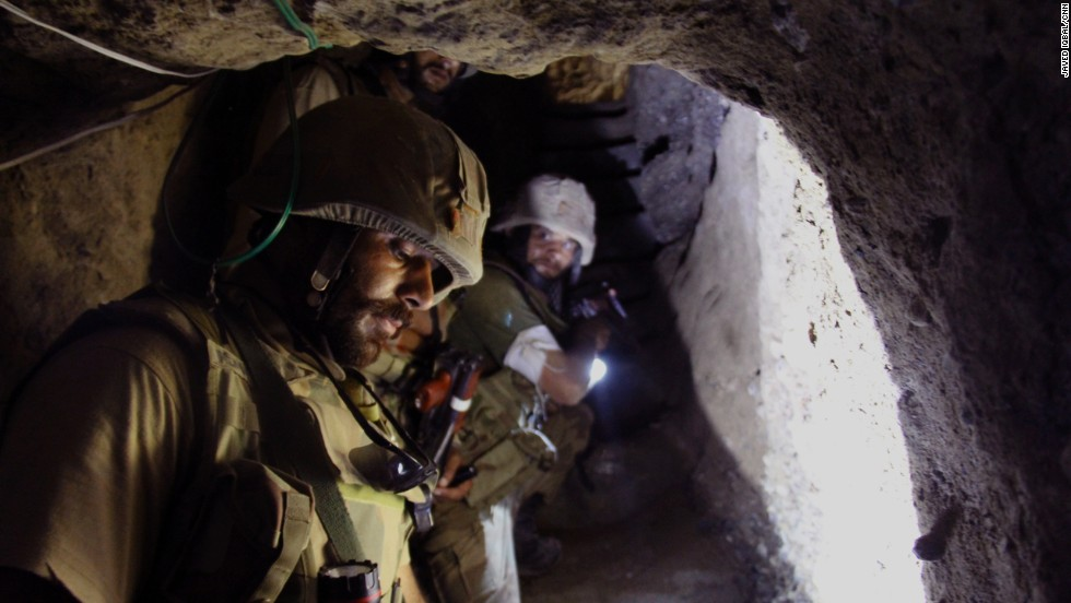 Pakistan army troops drop down into a the basement of a compound they believe was used by militants in a town in North Waziristan, where a massive ground offensive by the military has been taking place.