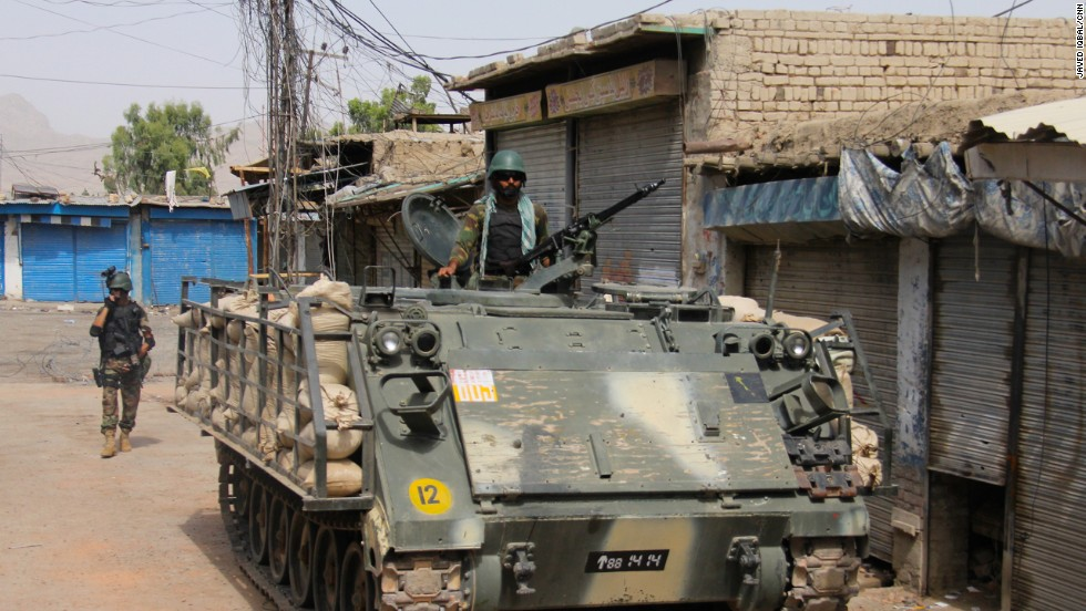 A Pakistan army armored vehicle rolls into the streets of Miranshah.